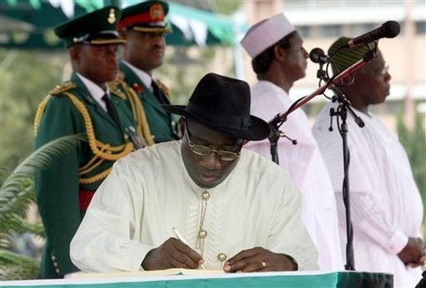An image of Of Goodluck Jonathan signing the bill
