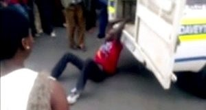South African Police Drag man to His Death