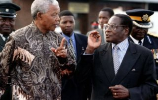President Robert Mugabe Blasts Mandela for Being Soft On Whites