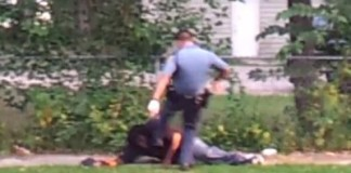 Video Shows Officer Savagely Beating Then Pepper Spraying Handcuffed Man In the Ear 2