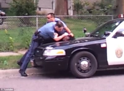 Video Shows Officer Savagely Beating Then Pepper Spraying Handcuffed Man In the Ear