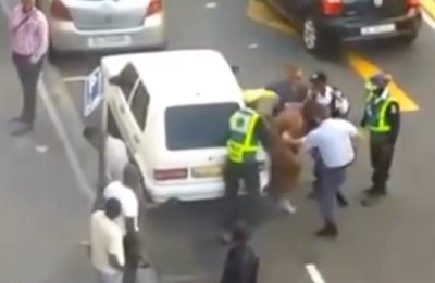 South African Police Beating Man