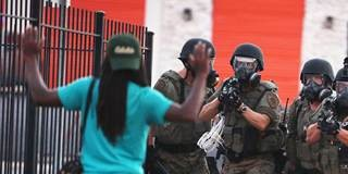 Ferguson Police Fire Teargas At Crowds Protesting Michael Brown Killing