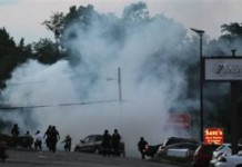 Ferguson Police Fire Teargas At Crowds Protest Michael Brown Killing