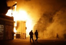 Ferguson: Businesses Ablaze, Bullets Fly In Overnight Rebellion Over Grand Jury