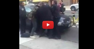 VIDEO:'This Is Not A War! It's A 12-Year-Old Boy'—Crowd Erupts As NYPD Cop Beats Handcuffed Boy