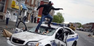 Protesters Clash With Paramilitary Police In Baltimore