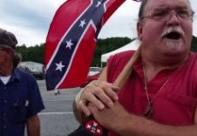 Ignorant Hick Unknowingly Wears African American Brand Shoes To Racist Klan Rally