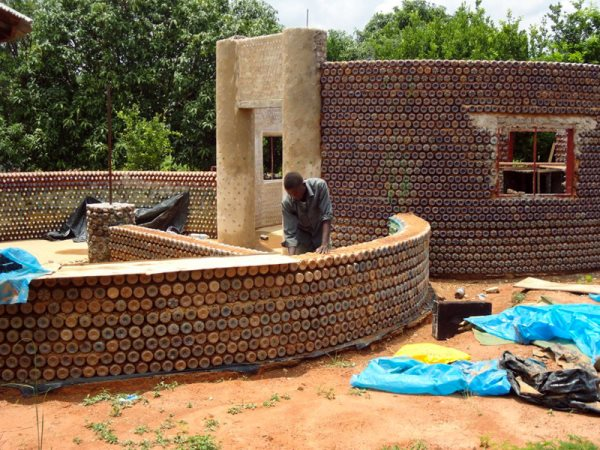 Nigerians Are Building Fireproof, Bulletproof, And Eco-Friendly Homes With Plastic Bottles And Mud