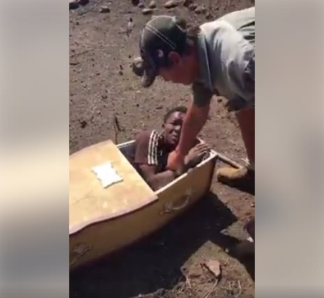 The Horrifying Moment White Settlers Force A Man Into Coffin And Threaten To Burn Him Alive