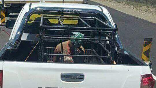Pregnant S. African woman is forced to ride in an animal cage by white farmer. This is the type of daily humiliation that South Africans have to deal with at the hands of white settlers, who still control the country's economy..